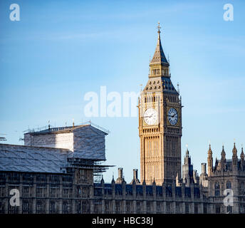 Elizabeth Tower containing the Ben Ben great bell, part of the tower's four faced clock - Stock Image