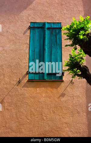 Colorful wood shutters on the quaint charming buildings in the seaport of Collioure France - Stock Image
