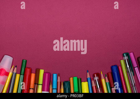 Copy space on colorful background with stationery. Back to school banner. Pens, pencils,markers. - Stock Image