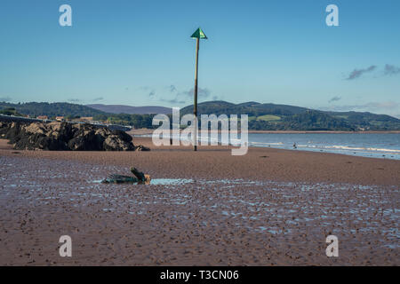 The beach in Blue Anchor, Somerset, England, UK - looking at the Bristol channel - Stock Image