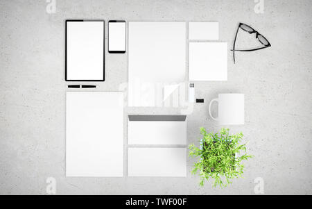 top view of devices and branding elements on concrete desktop mockup 3d rendering - Stock Image