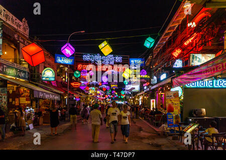 Siem Reap, Cambodia - 11th January 2018: Colouful neon lights of Pub Street. This is a popular night entertainment area for visiting tourists. - Stock Image