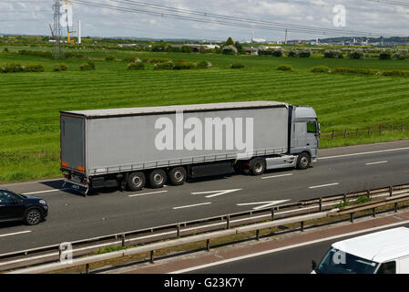 HGV travelling on the M56 motorway in Cheshire UK - Stock Image