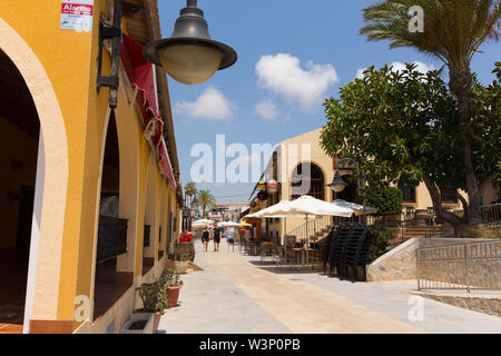 Mil Palmeras Costa Blanca Spain view of the main street with bars shops and restaurants - Stock Image