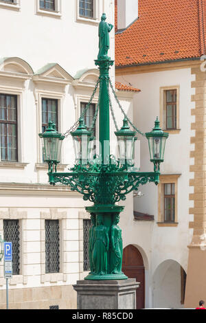 Prague Art Nouveau, view of a green Art Nouveau / Secession styled street light sited in Loretanska street in the Hradcany Castle district of Prague. - Stock Image