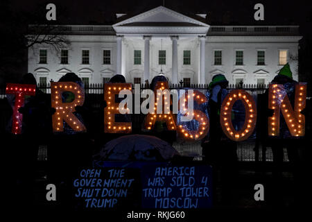 Demonstrators hold illuminated letter signs that read 'Treason' while protesting outside of the White House during the partial government shutdown in Washington, D.C., U.S, on Saturday, Jan. 12, 2019. - Stock Image