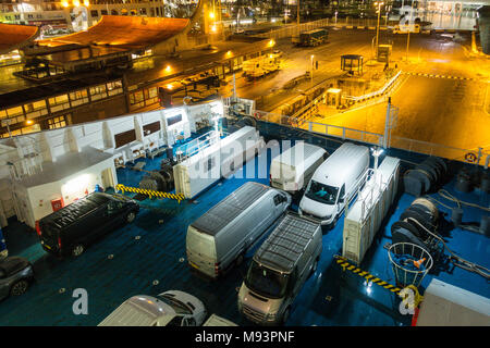 Loading vehicles onto a roll on roll off ferry at night in Santander, Spain - Stock Image