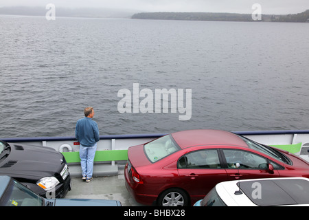 Passenger looking out of ferry on Lake Champlain - Stock Image