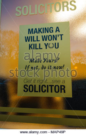 Solicitors frosted glass window etched with a statement, stating 'making a will won't kill you' & 'made yours? If not do it now!' 'Get it Right See a  - Stock Image