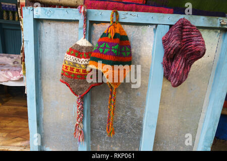 Woolen hats for sale at a guesthouse in the Annapurna region, Nepal. - Stock Image