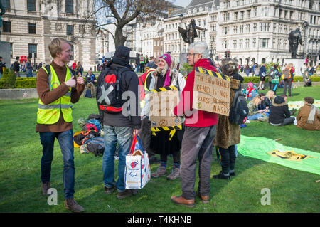 Demonstrators with banners congregate on Parliament Green, Westminster for the Extinction Rebellion demonstration - Stock Image