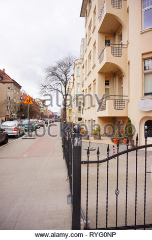 Poznan, Poland - March 8, 2019: Metal fence in front of a apartment building on the Slowackiego street. - Stock Image