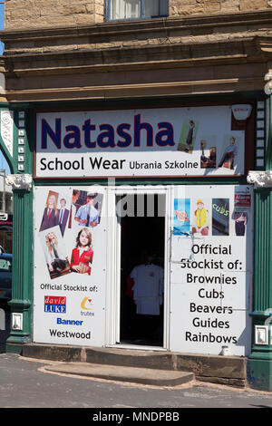 School wear shop with sign in Polish, Bradford, West Yorkshire - Stock Image