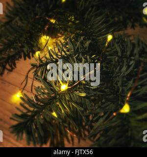 Close-Up Of Illuminated Christmas Tree - Stock Image