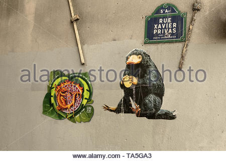 PARIS, FRANCE - APRIL 24:  Street art graffiti pieces depicting (Left) a Notre Dame cathedral burning with a lizard attached to the famous stained gla - Stock Image