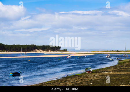 Boats moored in tidal river estuary in Findhorn Bay harbour. Findhorn, Moray, Scotland, UK, Britain - Stock Image