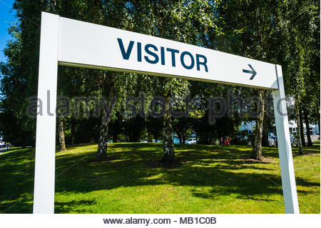 Visitor sign & arrow point direction to the BMW Group UK Ltd Group Vehicle Distribution Centre entrance sign for Mini & BMW in Thorne, Doncaster UK - Stock Image