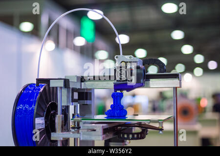 Automatic three dimensional 3D printer machine printing plastic model - Stock Image