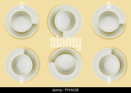 Minimal wallpaper made with empty coffee cup on yellow background - Stock Image