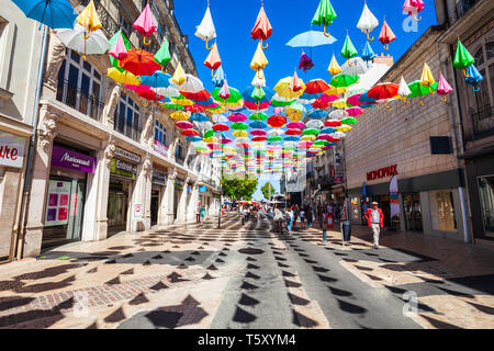 SAUMUR, FRANCE - SEPTEMBER 15, 2018: Franklin Roosevelt pedestrian street with umbrellas in Saumur city, Loire valley in France - Stock Image