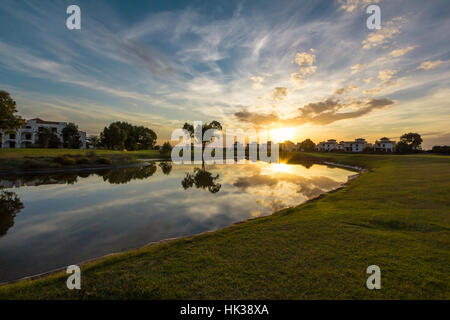 Beautiful sunset reflection on lake in Saidia golf course - Stock Image