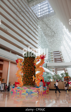 Marina Bay Sands Hotel reception atrium with Year of the Dragon (2012) display Singapore Malaysia - Stock Image