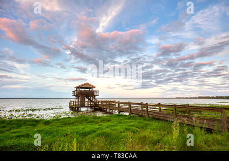 Late afternoon light over Lake Pierce at the Capernaum Lakeside Inn and Lodge in Lake Wales Polk County Florida in the United States - Stock Image