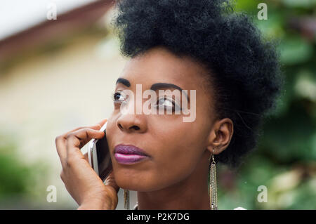 Close-up of a young woman focused on her communication - Stock Image
