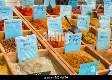 Collection of spices for sale at a market. - Stock Image