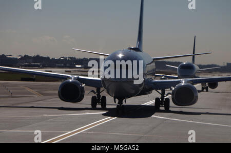 Airliners on tarmac in airport - Stock Image