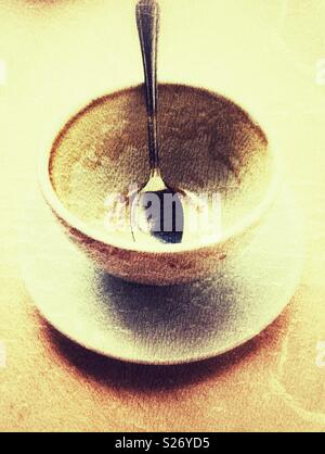Empty coffee cup with a spoon in it - Stock Image