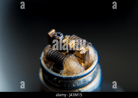 DIY RDA Dripper Coils with cotton stripes - Stock Image