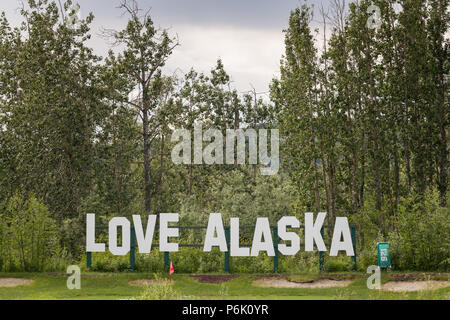 Love Alaska sign across the Chena River from Pikes Waterfront Lodge on a spring day in Fairbanks, Alaska. - Stock Image