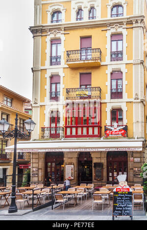 Gijon, Spain - 6th July 2018: Typical restaurant with outdoor seating. Al fresco eating and drinking is popular all over Spain. - Stock Image
