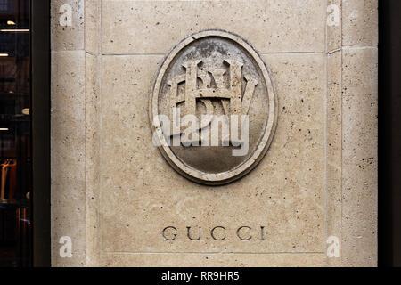Paris, 4th arrondissement, 2018, Bazar de l'Hôtel de Ville enterance with Gucci carved into the pillar. - Stock Image
