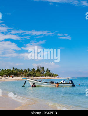 Dive boat returning to shore after taking tourists SCUBA divingoff the coast of Cuba. - Stock Image