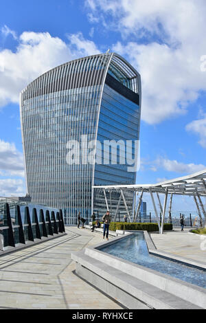 People in rooftop garden & water feature office block roof with landmark Fenchurch Street Walkie Talkie skyscraper building City of London skyline UK - Stock Image