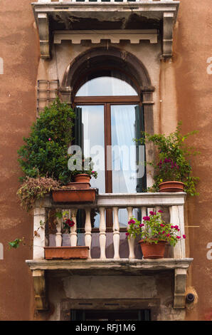Balcony in Venice overlooking the Canal - Stock Image