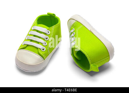 Sprawled Green Baby Shoes Isolated in White Background - Stock Image