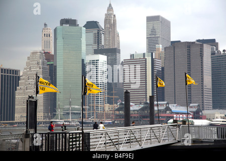 Downtown Manhattan skyline viewed through the NY Water Taxi dock on the Brooklyn side of the East River, New York, - Stock Image