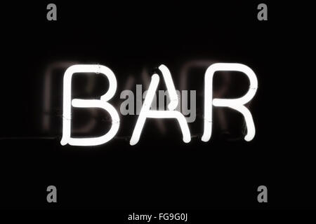White neon bar sign on a black background - Stock Image