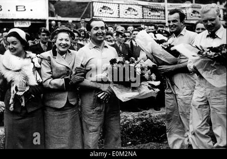 Apr 07, 1953; Pau, France; World Champion ALBERTO ASCARI won for the second time the Grand prix of Pau breaking records. The picture shows (from R-L), the second place, who was the British HAWTHORN, the third HARRY SHELL form the U.S. and the first one Ascari next to Madame BOURNAC, wife of the President of the A.C.B.B. and Madame DELAUNAY PREFETE after Ascari's victory. - Stock Image