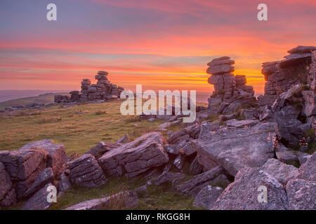 Vivid sunset from Staple tor Dartmoor national park Devon uk - Stock Image