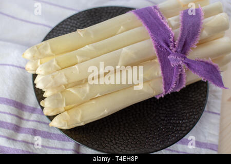 New harvest of white asparagus vegetable, high quality raw asparagus in spring season, ready to cook close up - Stock Image
