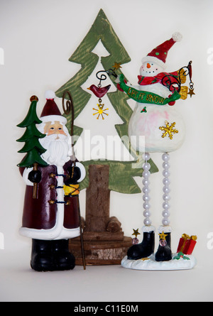 father,Christmas,santa,claus,st,nicholas,seasonal,decoration,snowman,frosty,tree - Stock Image