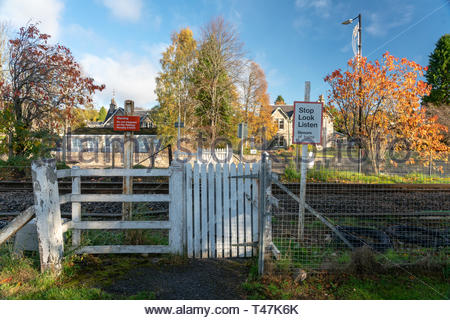 Signs warning about crossing rail lines in Pitlochry, Scotland - Stock Image