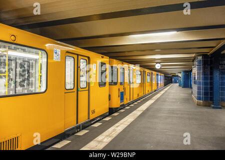 Uhlandstrasse underground U-bahn station serves U1 line with platform & yellow train. Berlin,Germany - Stock Image