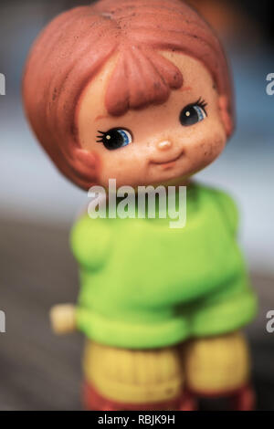 Wind up tin toy of a young girl - Stock Image