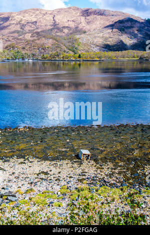 A washing machine thrown onto the shore of Loch Leven near Glen Coe in the Highlands of Scotland - an image showing pollution of the environment. - Stock Image