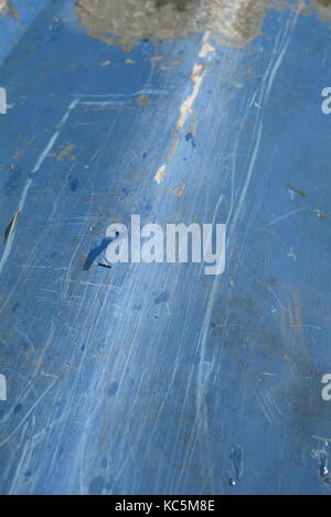 Fiberglass resin repairs on the hull of a blue rowing boat underside - Stock Image